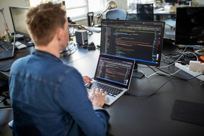 Stock photo of a man coding.