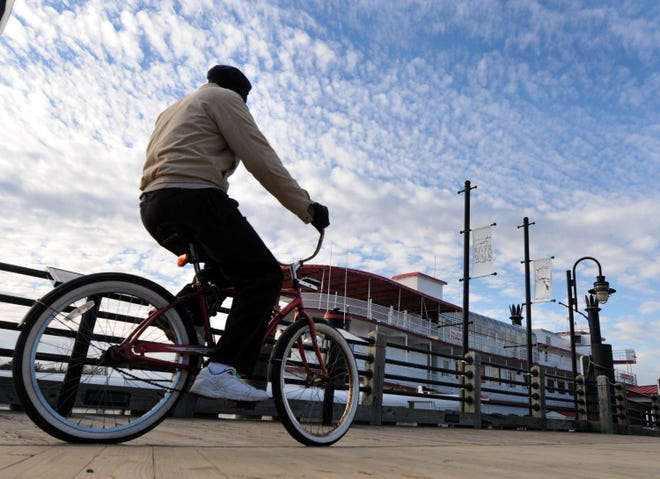 Charles Smalls rides his bike along the Wilmington Riverwalk on Jan. 17, 2014.
