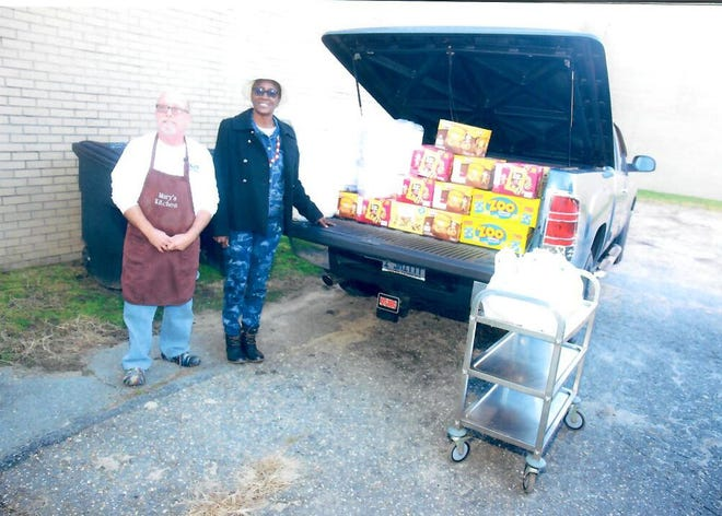 Pictured are Mr. Moore, director of Mary's Kitchen, Evelyn P Smith, former president of LaGrange Frink Alumni.  [CONTRIBUTED PHOTO]