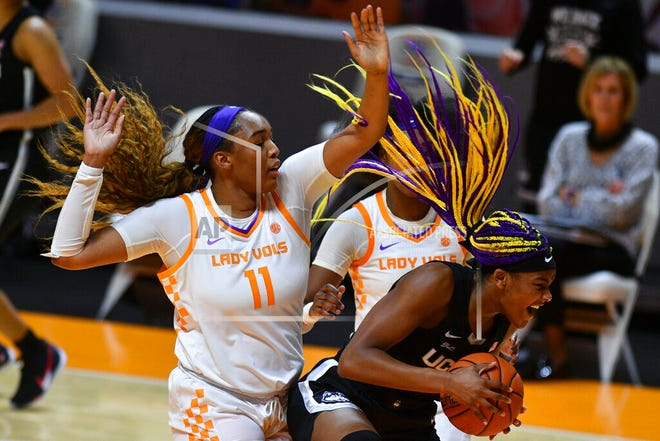 Connecticut's Aaliyah Edwards (3) attempts to keep a ball in bounds while defended by Tennessee's Kasiyahna Kushkituah (11) during an NCAA college basketball game in Knoxville, Tenn., Thursday, Jan. 21, 2021.