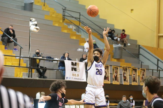 Topeka West senior Trevion Alexander shoots for 3 against Shawnee Mission North in the first round of the Topeka Invitational Tournament at Topeka High on Thursday evening.