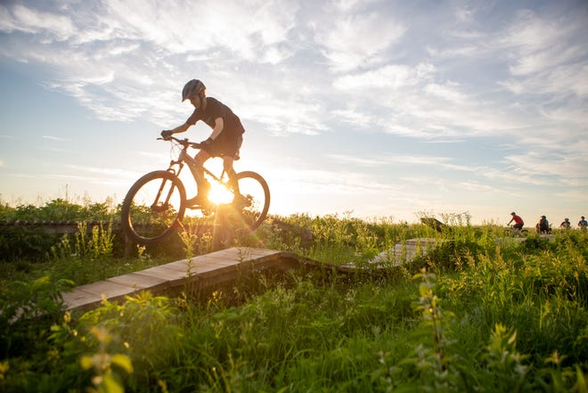 Brayden Stice, 12, jumps off a wooded skills section on June 8 atop Sunset Park in southwest Topeka during a group ride.