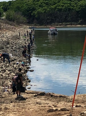 Anglers flock to the banks of Perry Reservoir in Jefferson County during the crappie spawn in May 2020. The COVID-19 pandemic didn't hurt fishing license sales in Kansas, and may have even actually helped them.