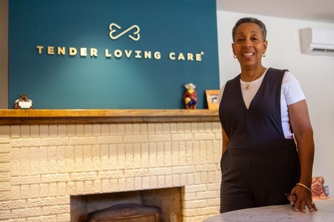 Leslie Fleuranges, owner of Tender Loving Care Pet Nursing Hotel, poses for a photo in her lobby shortly after opening last year. Fleuranges is frustrated that the timing of her opening has prevented her from accessing much-needed COVID-19 relief.