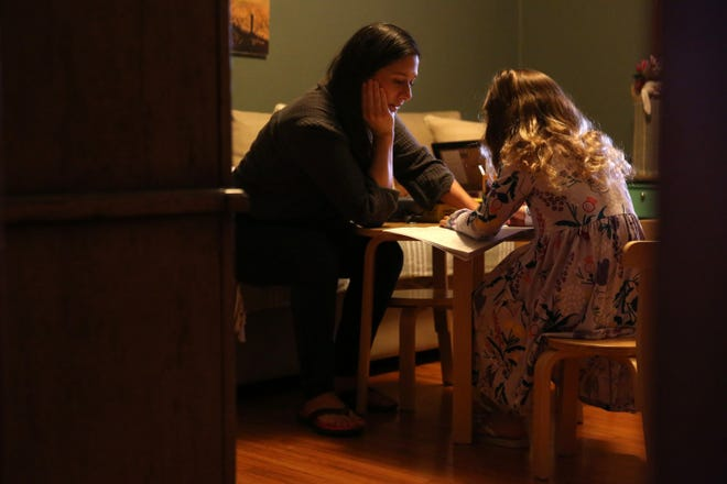 Cindy Carcamo crafts with her 5-year-old daughter at home in Santa Ana Dec. 26 in Orange County, California.