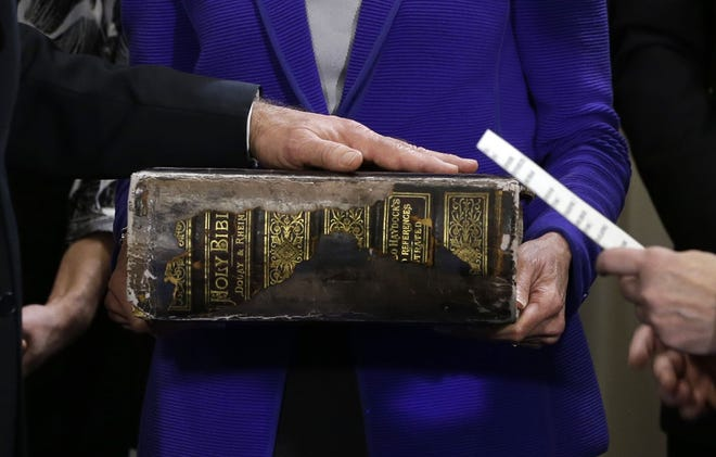 Vice President Joe Biden, left, places his hand on the Biden family Bible held by his wife, Jill Biden, center, as he takes the oath of office Jan. 20 in Washington, D.C.