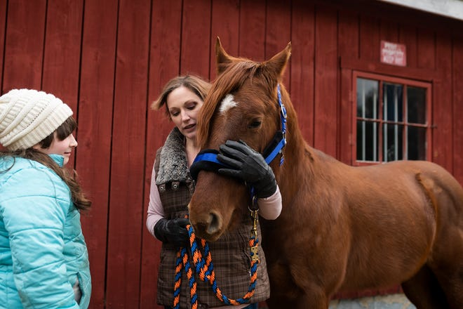 Horse trainer Becky Hupfeld, right, and her 10-year-old daughter Tessa Proietti-Hupfeld, are raising funds for two surgeries that their rescue horse Princeton needs in order to remove a bone cyst from his skull.