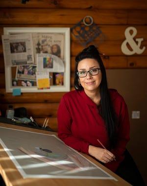 Artist Lisa J works in her Sturbridge home studio last month.