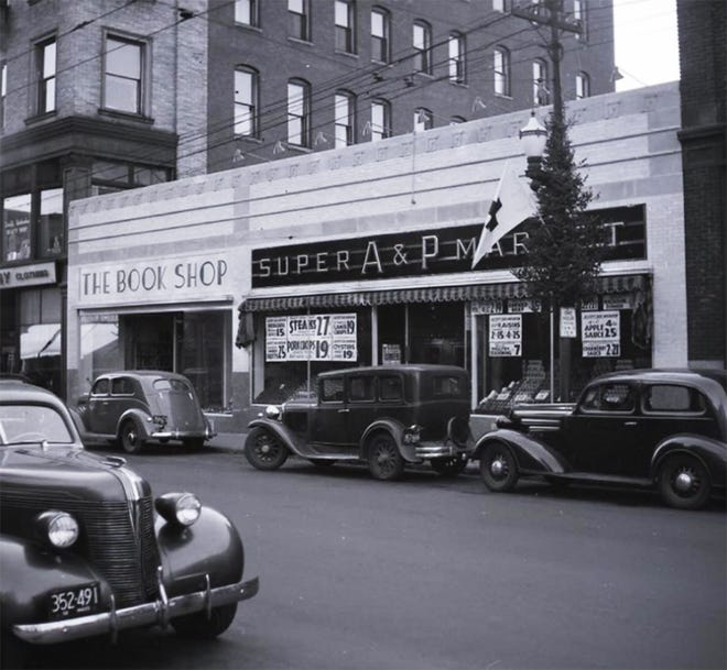 This building at 536-540 Main St. in Fitchburg remains, with a modern facade. In the background is the Johnsonia Building, which burned a decade ago. Is is now an empty lot.