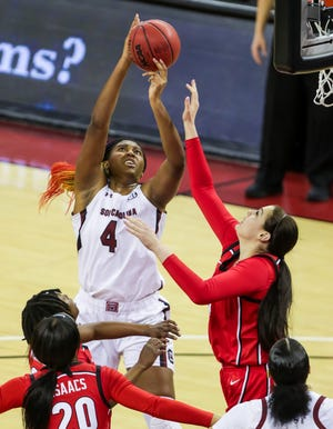 South Carolina forward Aliyah Boston (4) is fouled by Georgia center Jenna Staiti in the first quarter Thursday night.