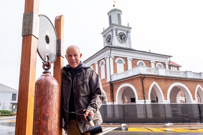 """Artist John Shoneman installs his work """"The Unity Bell"""" in the Cool Spring Downtown District on Jan. 5. This public interactive sculpture will be on display outside 100 Hay Street through Feb. 28."""