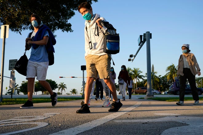 Students arrive for classes at a maritime and science technology magnet high school in Miami.