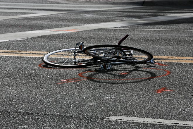 Spray paint marks the street around the bicycle of 20-year-old University of Florida student Abigail Dougherty, who struck by a truck and killed while crossing West University Avenue on Oct. 28, 2014.