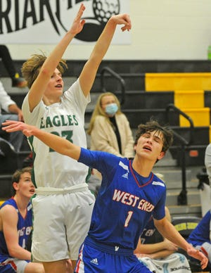 Hokes Bluff's Jordan Presley shoots a 3-pointer as West End's Kyle Edwards defends during the semifinals of the Etowah County boys basketball tournament Thursday, Jan. 21, 2021, at Glencoe High School.