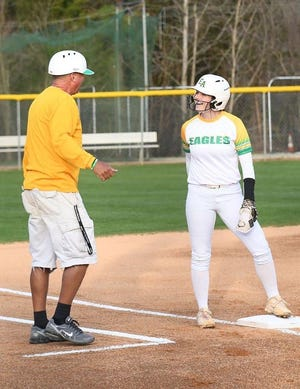 Eastern Alamance's Maddie Lawson, right, chats with coach Danny Way while on third base.