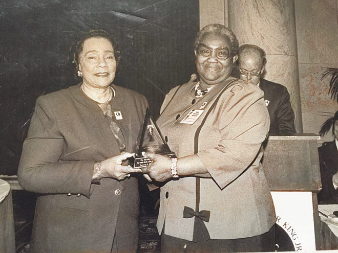 Coretta Scott King (left) presents Ruth Steele and the Pueblo Martin Luther King Jr. Holiday Commission with The Making of the King Holiday Award on Jan. 8, 1996.