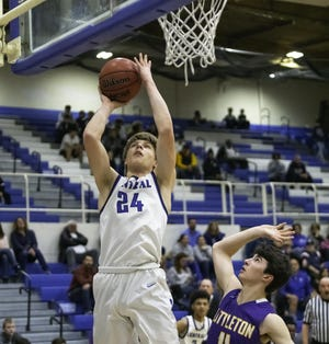 Pueblo Central's Kyle Bigley, left, goes up for a layup against Littleton in the first round of the Class 4A state tournament Feb. 26, 2020, at Jim Ranson Court.
