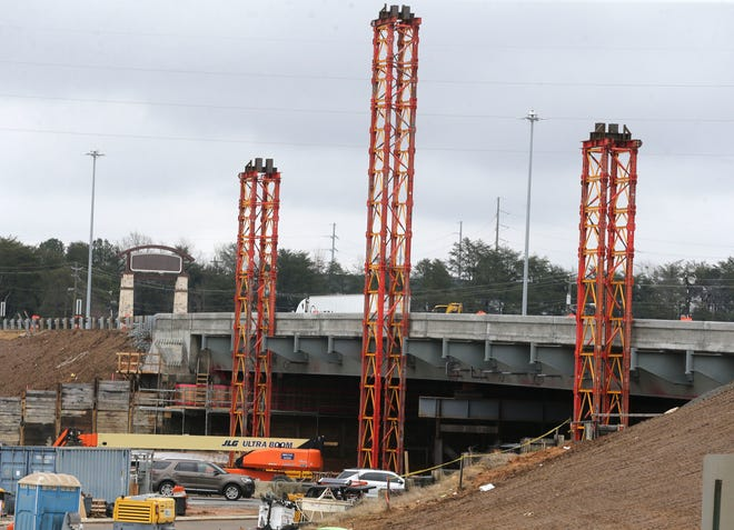 The crew working Friday, Jan. 22, 2021 on the Interstate 20/59 overpass at McFarland Boulevard has erected scaffolding to help when the arch is set on the west side next week. [Staff Photo/Gary Cosby Jr.]