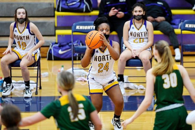 North Henderson's DeBria Waters (24) takes a jumper during Thursday night's home game against A.C. Reynolds.