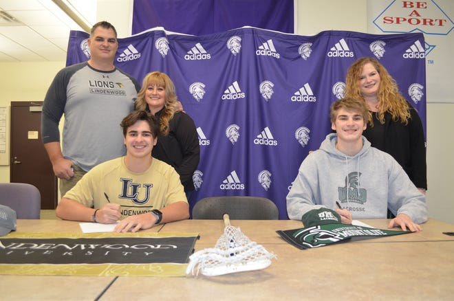 Lakeview seniors Dawson Gillette, left, and Dominic Puhalj are joined by their parents as they announce their commitment to play college lacrosse. Gillette will be going to Lindenwood University and Puhalj will play at Mount Olive University.