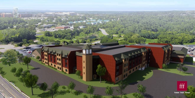 New color scheme: The DoubleTree by Hilton hotel and conference center (formerly the Sheraton) in South Burlington is seen in a design rendering created by Freeman French Freeman architects for a design-build project with DEW Construction. This aerial view is from the southeast.