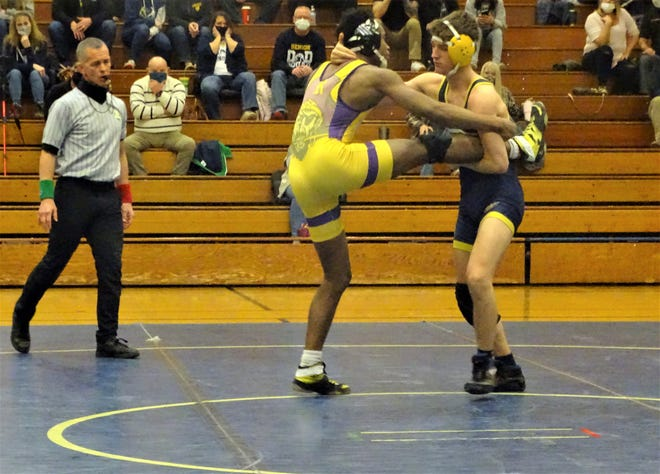 Lancaster senior Jacob Reed gets set for a takedown against Reynoldsburg Thursday night. Reed eventually recorded a pin in the Golden Gales' 69-6 victory.