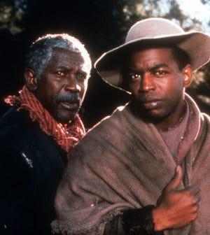 "Lou Gossett Jr. (left) and LeVar Burton star in the mini-series ""Roots."""