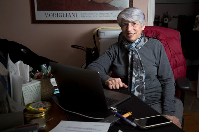 Dr. Judith Feinberg, a specialist of infectious disease, who started the first syringe exchange program in Greater Cincinnati, The Cincinnati Exchange Project, pauses from work in her home office in Amberley, Ohio, on Thursday, Jan. 21, 2021. Feinberg now works for West Virginia University.