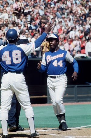 Hank Aaron crosses home plate after hitting his 714th home run off the Reds' Jack Billingham at Riverfront Stadium on April 4, 1974. The homer tied Babe Ruth's all-time record.