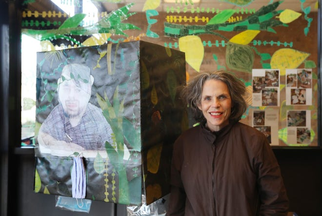 Anne Cornell is  director of the Pomerene Center for the Arts. She is seen with one of the missions of the center, public art. The piece is by a resident of Gentlebrook Lafayette Meadows, and can be seen at Buellers in Coshocton.