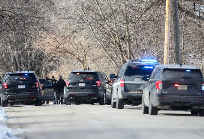 Fond du Lac County Sheriff's Department and Wisconsin State Patrol vehicles block the road  Jan. 22 on Grove Street, north of Hickory Street in the City of Fond du Lac while investigating a crash scene of a vehicle that crashed after a pursuit that started as a complaint of a reckless driver on Interstate 41 and then exited into the city.