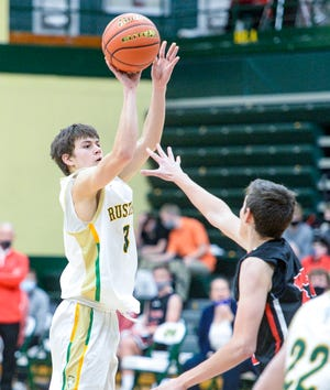 CMR's Trey Wasson shoots a three pointer during Thursday's basketball game against Bozeman.