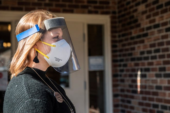 """Cassie Duggin, Business Development Coordinator at Brookdale Jackson Oaks, speaks with the media about their """"shot of hope"""" event on Friday, Jan 22, 2021 in Jackson, Tenn. The party was in honor of their first COVID-19 vaccine clinic which included a photo booth, balloons, cupcakes and music."""