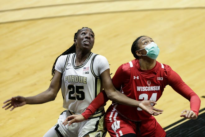 Purdue forward Tamara Farquhar (25) is boxed out by Wisconsin forward Imani Lewis (34) during the fourth quarter of an NCAA women's basketball game, Thursday, Jan. 21, 2021 at Mackey Arena in West Lafayette.