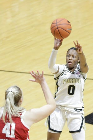Purdue guard Brooke Moore (0) goes up for a 3-pointer during the fourth quarter of an NCAA women's basketball game, Thursday, Jan. 21, 2021 at Mackey Arena in West Lafayette.