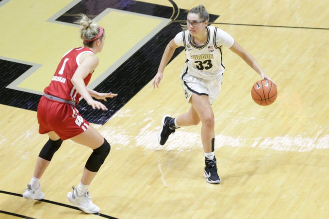 Purdue guard Madison Layden (33) dribbles against Wisconsin guard Estella Moschkau (1) during the fourth quarter of an NCAA women's basketball game, Thursday, Jan. 21, 2021 at Mackey Arena in West Lafayette.