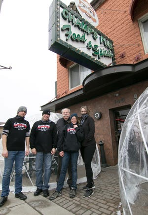 """Staff at Champ's Pub in Brighton, from left, cooks Sean Wilson and Scott Claxtonsteine, owner Dave """"Champ"""" Beauchamp, server Chelsea Hamilton and bartender Kerri Sauve, shown Friday, Jan. 22, 2021, are preparing to reopen indoor dining Feb. 1."""