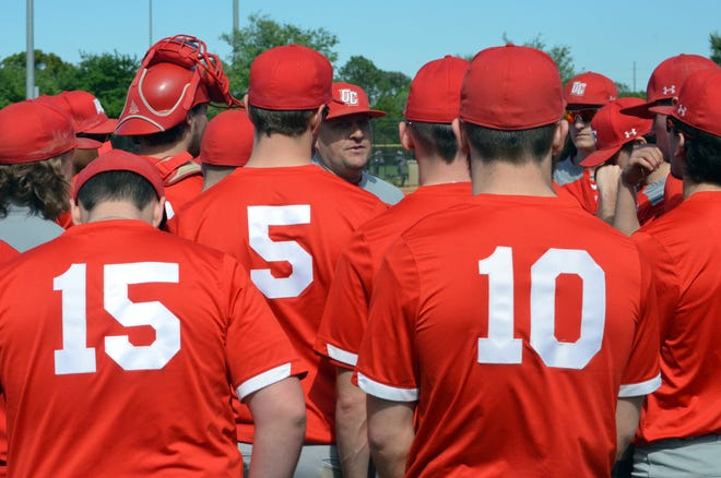 Andy Merchant, the new baseball coach at Fowlerville, addresses his players while coaching at Olivet College.