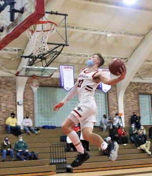 St. John's Northwestern guard Brandin Podziemski rises for a windmill dunk against Oak Creek on Jan. 21, 2021.