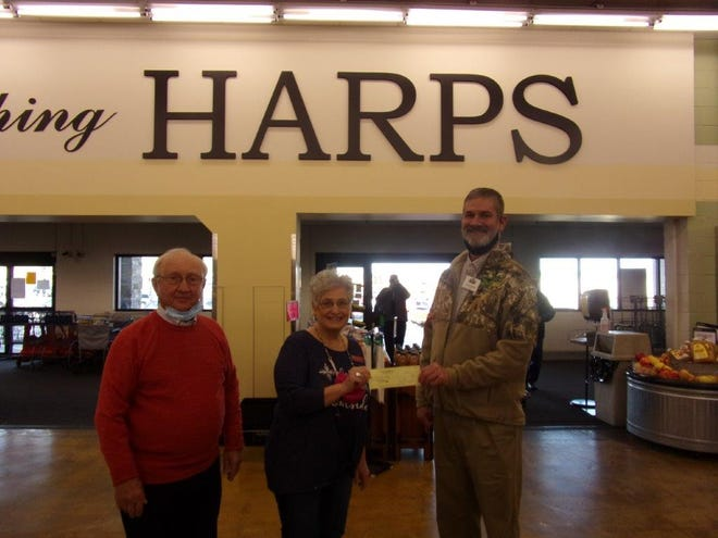 Shown above are, from left, Robert Nosari, Sandra Anderson and Greg Harp at the check presentation for the Ozark Center of Hope.