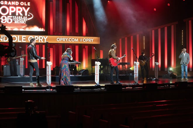 Darius Rucker surprises Lady A with an invitation to join the Grand Ole Opry during a taping for the NBC special 'Grand Ole Opry: 95 Years of Country Music'