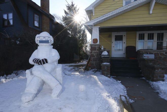 A snow sculpture of Vermont Sen. Bernie Sanders, built by local artist Jef Schobert, is seen on Friday along Clark Street in Stevens Point. The sculpture mimics the internet meme born from Sanders' appearance at Joe Biden's presidential inauguration on Jan. 20.