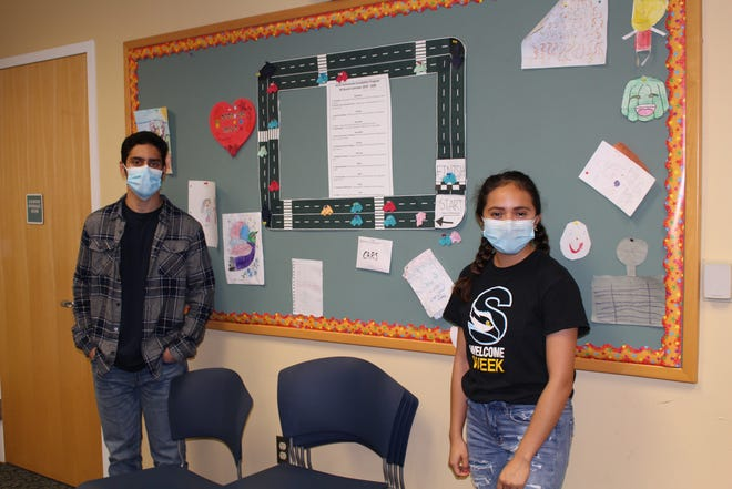 Hari Acharya (left) of Mays Landing and Ariana Ramirez of Northfield are among the Stockton University student tutors participating in the After-School Homework Completion Program sponsored by Stockton's Center for Community Engagement and Service Learning.