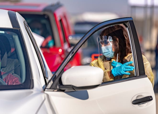 Nurse Veronica Vera prepares a COVID-19 vaccine during the drive-thru event at the International Agri-Center in Tulare on Thursday, January 21, 2021.