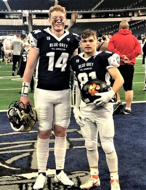 New Lexington senior Shaun Pletcher (81) posed with East teammate Seth Smith (14) after the recent Blue-Grey All American Bowl game at AT&T Stadium, home of the Dallas Cowboys. The East won 25-24.