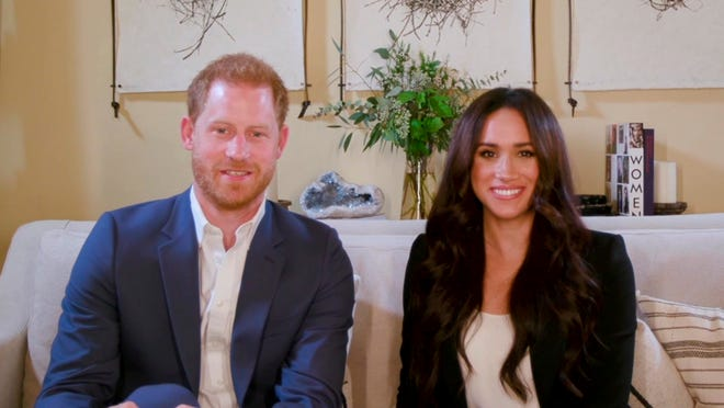 This screengrab shows Prince Harry Harry and Duchess Meghan of Sussex, hosting a special Time100 talk, Oct. 20, 2020, focusing on the digital world. They want to help make online communities safer and free of misinformation.