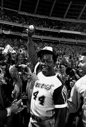 Hank Aaron celebrates after his 715th career home run in 1974.