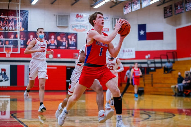 Westlake guard Cade Mankle races to the basket for the shot against the Bowie Bulldogs during the first period at the District 26-6A boys basketball game on Friday at Bowie High School. Mankle scored a team-high 18 points as Westlake beat Bowie 63-51 to remain perfect in District 26-6A.