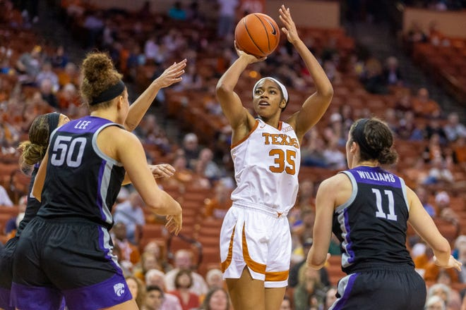Texas center Charli Collier scores over Kansas State's Ayoka Lee during their game in Austin last season. Collier is being projected by some as the possible No. 1 overall pick of this year's WNBA draft.