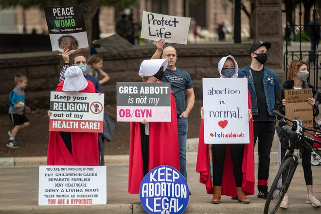 Abortion rights supporters stood in silence as they gathered next to supporters for Texas Rally for Life near the Capitol earlier this year.
